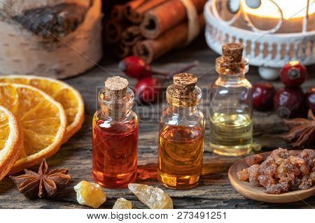 Christmas Collection Of Essential Oils With Myrrh, Frankincense, Cinnamon And Star Anise