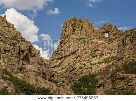 A Beautiful Scenic View Of A Small Natural Arch In Some Rocky Peaks In The Colorado Rocky Mountains.