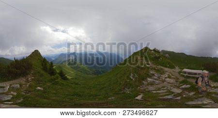 Middle age man hiking in Switzerland mountains at summer, 360 panorama