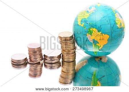 Money Piled Up On A Table With The Globe No People Stock Photo