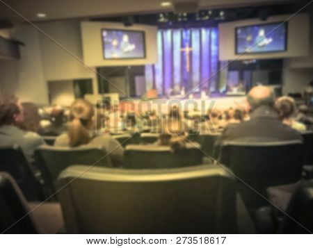 Filtered Image Blurry Background Rear View Audience At Bible Church With Preacher On Stage