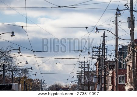 Electric Power Lines, On Wooden Poles, Electricity Supply, Phone Lines And Streetcar Cables, Abiding