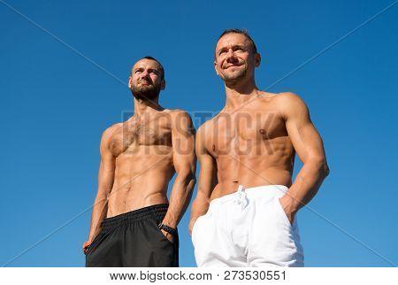 Feel Confidence. Men Muscular Body Posing Confidently. Guys Muscular Belly Posing. Sport And Bodycar