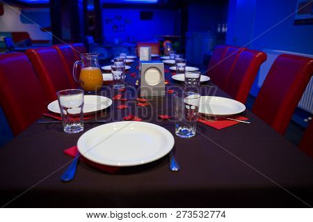 Restaurant Table Served With Plates And Glasses.table Prepared For Party In Cafe Or Restaurant. Cate
