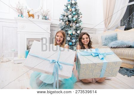 Delivery Christmas Gifts. Family Holiday. Happy New Year. Happy Little Girls Sisters Celebrate Winte