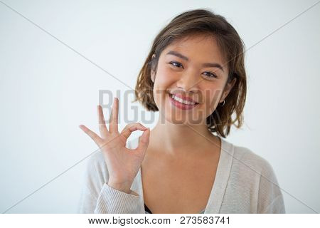 Portrait Of Happy Young Woman Gesturing Alright. Asian Girl Showing Satisfaction Sign. Success Conce