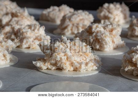 Homemade Coconut Macaroons Coconut Meringue Cookies In Baking Pan Paper, Close Up. Coconut Macaroons