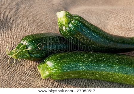 Organic Zucchini On Sackcloth Background