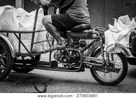 Poor Senior Man Driving A Motorbike, Sending Ice Bag To A Restaurant. Elderly People Work After Reti