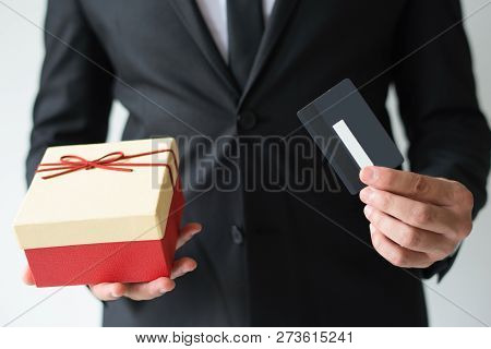 Close-up Of Unrecognizable Man Recommending To Use Credit Card For Christmas Shopping. Businessman I