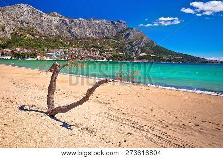 Town Of Omis Sand Beach And Biokovo Mountain Coastline View, Dalmatia Region Of Croatia