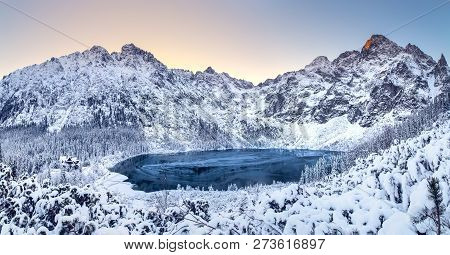 Winter Dawn In Mountains. Beautiful Winter Landscape With Mountain Lake And Snowy Hills. Morskie Oko