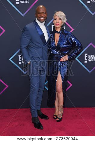 LOS ANGELES - NOV 11:  Terry Crews and Rebecca King-Crews arrives for the 2018 People's Choice Awards on November 11, 2018 in Santa Monica, CA