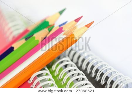 pencils with spiral bound notebooks