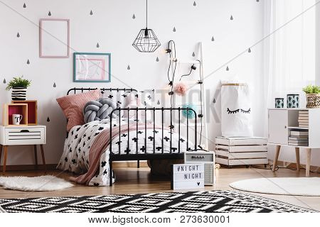 Black And White Patterned Carpet On Wooden Floor In Stylish Kid's Bedroom Interior With Scandinavian