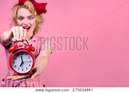 Smiling Pin-up Woman Holding Clock. Amazed Pin Up Woman In Red Dress Holds Red Clock. Pin Up Style L