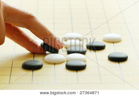 Playing igo or Go