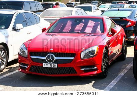 Dubai, Uae - November 15, 2018: Red Motor Car Mercedes-benz R231 Sl-class In The City Street.