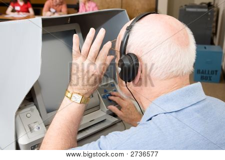 Senior Man Uses Touch Screen