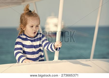 Little Boy With Surprised Face. Childhood And Happiness Concept. Adorable Kid In Striped Blue And Wh