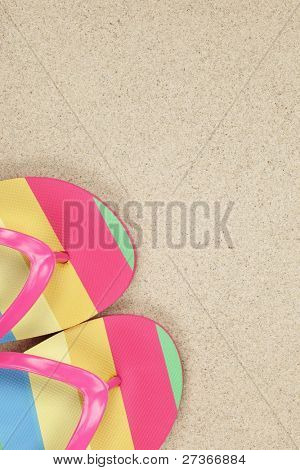 flip flops on sand beach with copy space