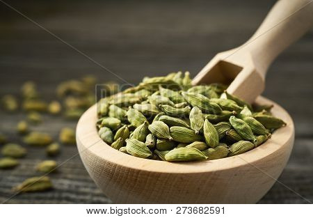 Green Cardamom Pods  On A Gray Wooden Background
