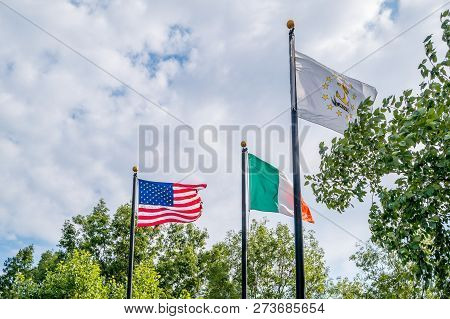 Flags Of United States, Irland And Rhode Island State Fluttering Against A Blue Sky, Near Rhode Isla