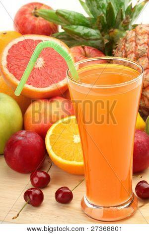 Closeup of fruit juice with fruits