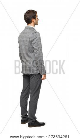 Side view of Business man  looks.  Rear view people collection.  backside view of person.  A young guy in a gray suit is looking sideways.