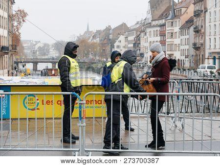 Strasbourg, France - Dec 11, 2018: Side View Of Police Surveilling The Entrance To Strasbourg Christ