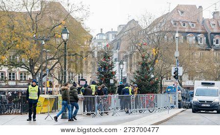 Strasbourg, France - Dec 11, 2018: Rear View Of Police Surveilling The Entrance To Strasbourg Christ