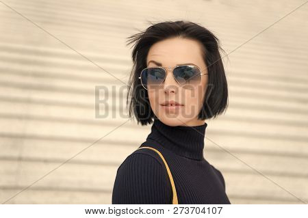 Woman In Sunglasses On Stairs. Look, Beauty, Style. Ambition, Challenge, Success Concept. Girl With