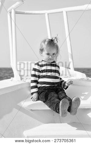 Explore World. Child Cute Sailor On Yacht Sunny Day. Adventure Of Boy Sailor Travelling Sea. Boy Ado