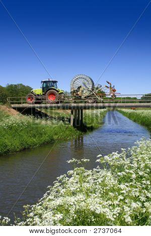Tracktor Driving Over Bridge