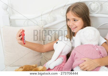 Girl With Smartphone Use Modern Technology. Selfie With Favorite Toy. Send Selfie Photo Your Friends