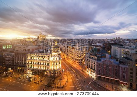 Car And Traffic Lights On Gran Via Street, Main Shopping Street In Madrid At Night. Spain, Europe. L