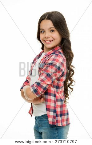 Feel So Confident With New Hairstyle. Kid Girl Long Curly Hair Posing Confidently. Girl Curly Hairst