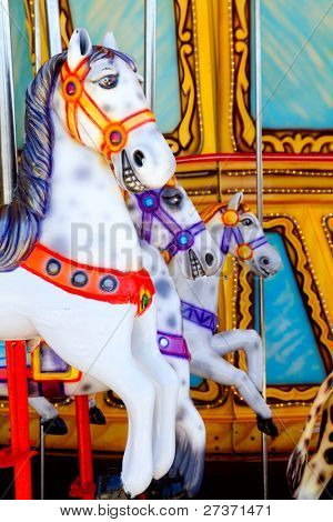 horses in merry go round fairground attraction