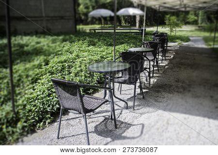 Sidewalk Cafe Seats In Garden, Stock Photo