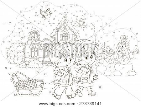 Smiling Little Girl And A Boy Walking With A Small Sled Against A Snow-covered House And A Funny Sno