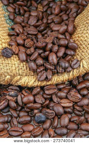 Coffee Beans In Burlap Sack Stock Photos