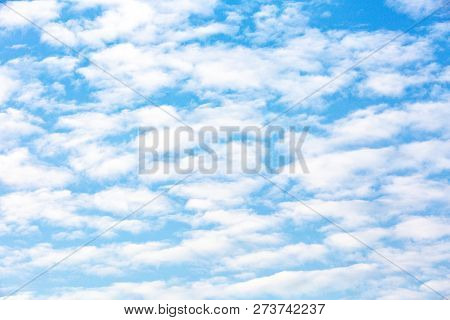Blue Sky With Small White Spread Clouds
