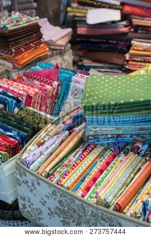 Traditional Fabric Store With Stacks Of Colorful Textiles, Fabric Rolls At Market Stall - Textile In