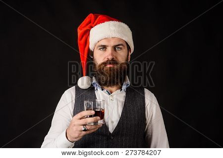 New Year Party. Bearded Man Drink Whiskey. Handsome Rich Man With Stylish Mustache And Beard Hold Gl