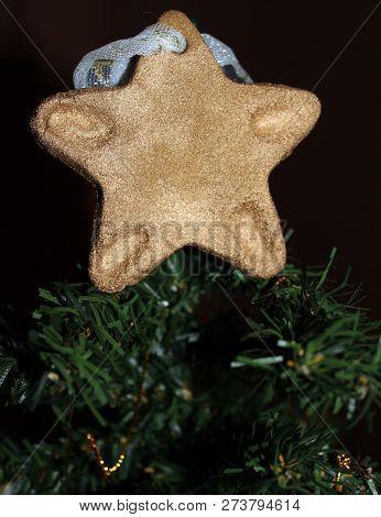 handmade gingerebread topper ornament on Christmas tree poster