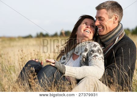 Romantic Young Couple In Autumn Landscape