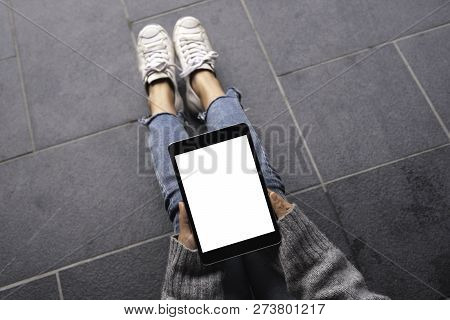 Top View Mockup Image Of Woman's Hands Holding And Using Black Tablet Pc With Blank White Desktop Sc