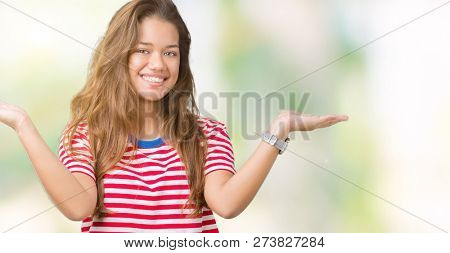 Young beautiful brunette woman wearing stripes t-shirt over isolated background Smiling showing both hands open palms, presenting and advertising comparison and balance