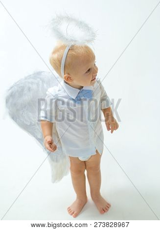 Ready For Holiday. Adorable Little Angel Boy. Little Boy With Angel Wings And Halo. Baby Angel. Cute