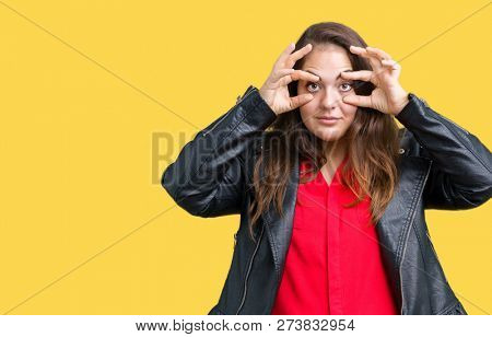 Beautiful plus size young woman wearing a fashion leather jacket over isolated background Trying to open eyes with fingers, sleepy and tired for morning fatigue